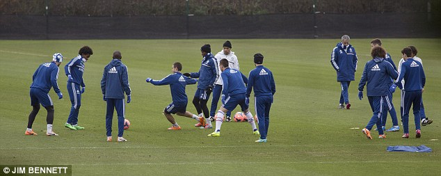 Getting up for the Cup: All the players are involved in a keep-ball exercise before the FA Cup tie against Stoke