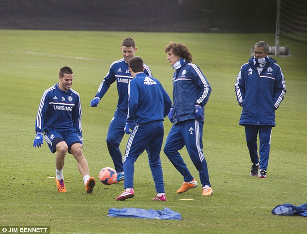 There's no Juan there: Chelsea players at Cobham training ground on Wednesday, minus Juan Mata