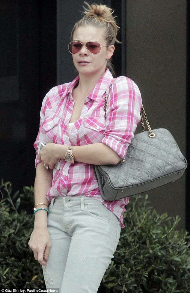 Rose-colored glasses: LeAnn Rimes dressed down and shopped for clothes in Los Angeles on Tuesday