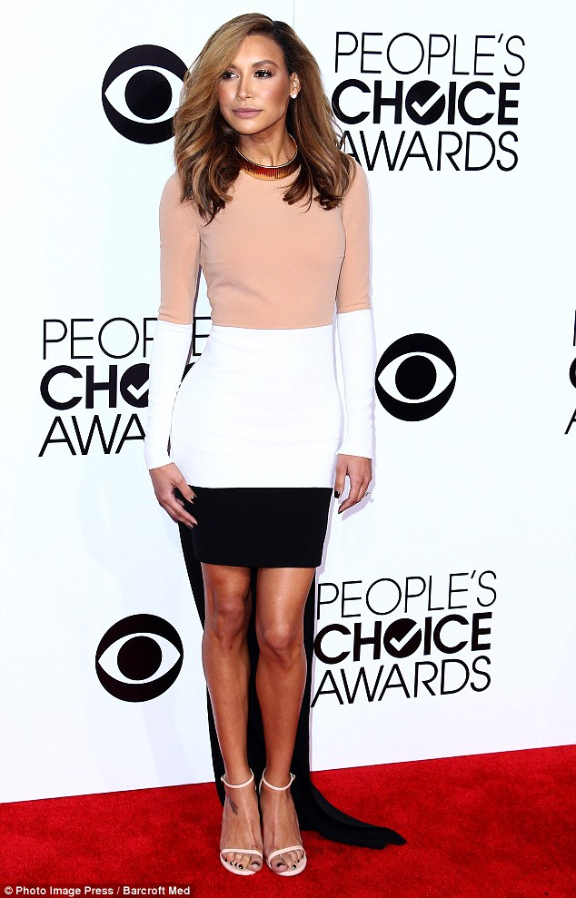 Lighten up: Naya debuted a blonder look at the People's Choice Awards, where she wore this flattering tri-color Michael Kors dress with a train