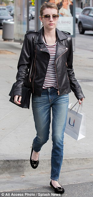 Shopper chic: The 22-year-old teamed jeans with a red and white striped top, black leather jacket and cute black Charlotte Olympia flats with cat face design, while she also carried a black handbag and a U Luxury haircare shopping bag