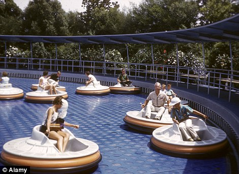 Visitors enjoy one of the park's many rides in 1962