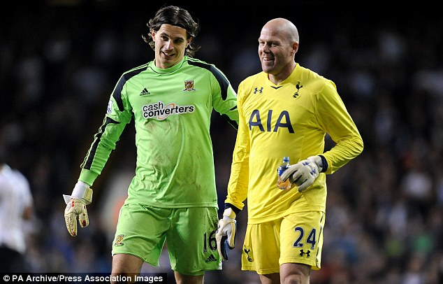 Keepers' union: Friedel (right) chats to Hull stopper Eldin Jakupovic before Spurs' penalty shootout victory over Hull in the Capital One Cup earlier this season