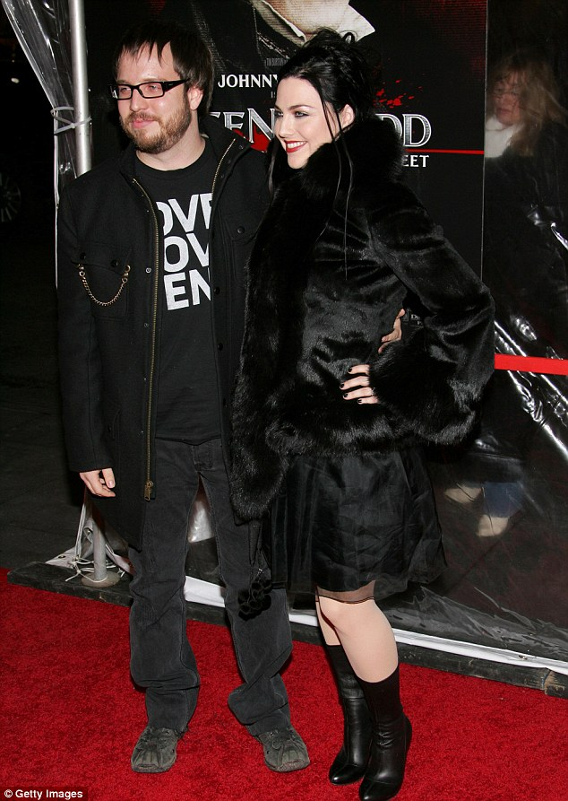 Growing family: The 32-year-old is married to therapist Josh Hartzler, pictured in New York in December 2007