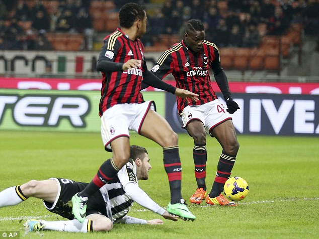 In the right place: Balotelli scores for AC Milan against Udinese