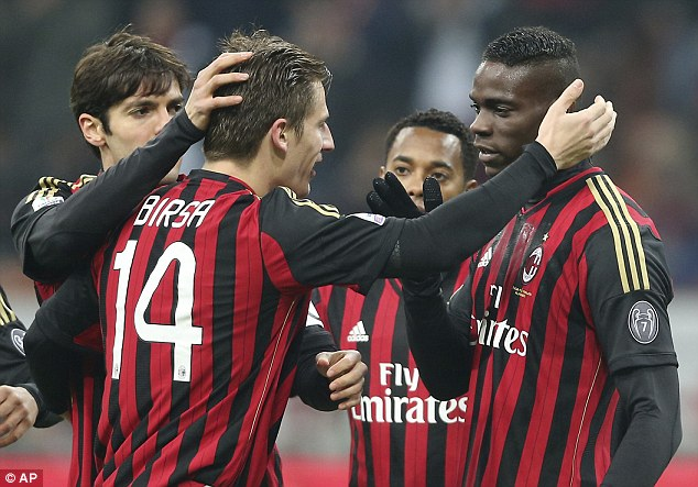 Perfect start: AC Milan's Mario Balotelli celebrates with teammates Kaka, left, Robinho, second from right, and Valter Birsa after opening the scoring against Udinese
