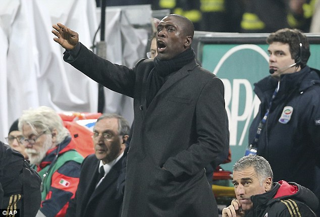 Bad day at the office: AC Milan boss Clarence Seedorf watched his side lose 2-1 to Udinese