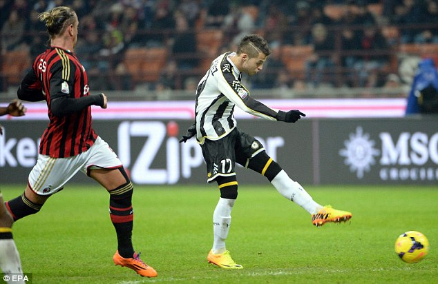 Crucial moment: Lopez hits the winning goal for Udinese against AC Milan in the Copa Italia quarter-final