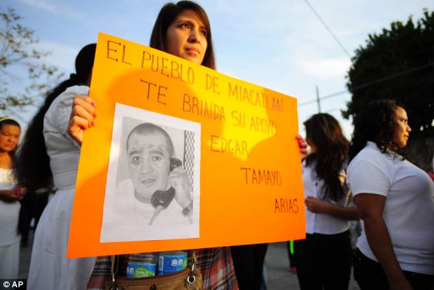 Pleas for mercy: A woman holds up a sign showing a photo of Texas death-row inmate Edgar Tamayo that reads in Spanish 'The town of Miacatlan offers you our support, during a protest demanding clemency