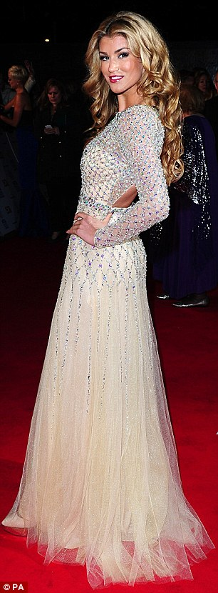 Golden girl: Looking every inch the fairytale princess, the 21-year-old commanded attention as she glided down the red carpet in a golden embellished keyhole gown