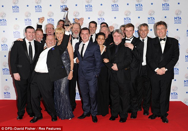 Time to celebrate! Brendan O'Carroll and the cast and crew of Mrs Brown's Boys toasted their Best Comedy win backstage