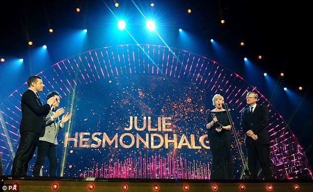 The big winner! Julie looked positively delighted as she arrived on stage to collect her prize