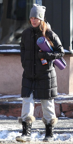 Smoothie: The star held a drink in her hand as she trudged through the snow