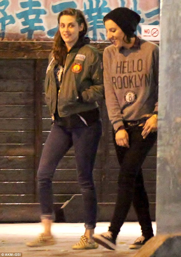 Low-profile: Kristen Stewart dressed in her typical grunge style as she grabbed sushi with a friend in Little Tokyo in Los Angeles on Wednesday