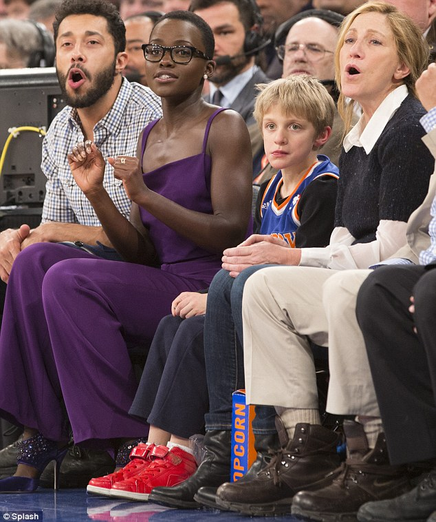 Ooohhh: Lupita and Edie got very involved but Anderson looked a bit disconnected. The 12 Years A Slave star  had to wear her stunning purple trouser suit as she went straight to The Jimmy Fallon Show after the game