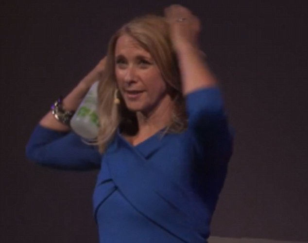 It's a hair affair: Next her hair, which she normally spends 45 minutes styling, gets a dousing with water to show the presenter's natural look