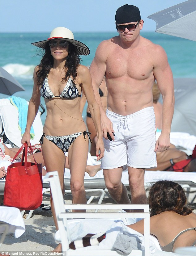 Beach babe: A very slender Bethenny was spotted with hunky financier Michael Cerussi on the beach in Miami over the New Year holiday
