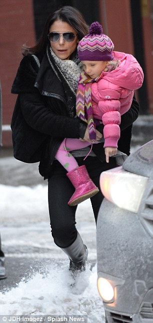 What's this stuff? The three-year-old pointed to the snow but her mother, 43,  was taking no chances and held her little girl close