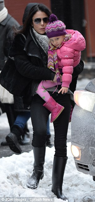 Nice ice, baby: Mother and daughter were warmly dressed on a day when the temperature hit a low of 7F before rising to a very chilly 20F