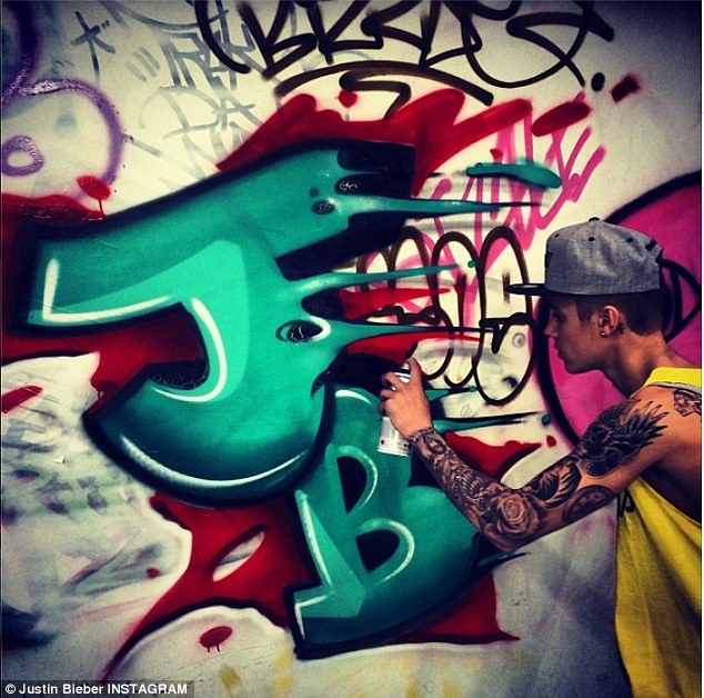 JB dabber: Justin then painted his initials onto the wall using a can of spray paint as his adventure ended