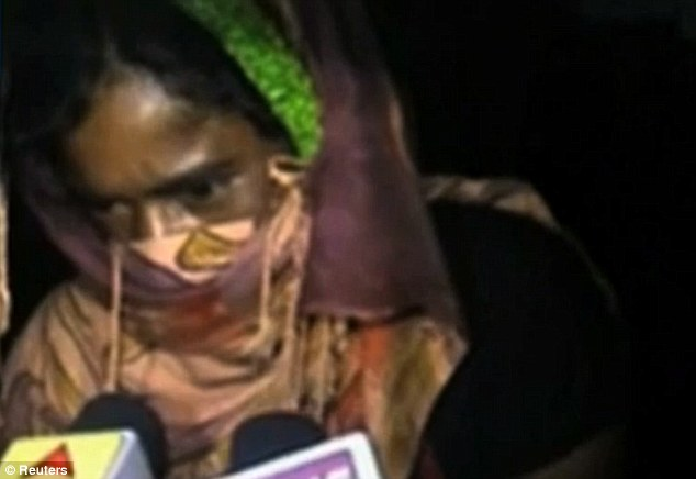 Abhorrent: The 20-year-old woman, pictured arriving at a hospital in Western Bengal, was  raped by more than a dozen men while tied to a bamboo platform in front of the entire village