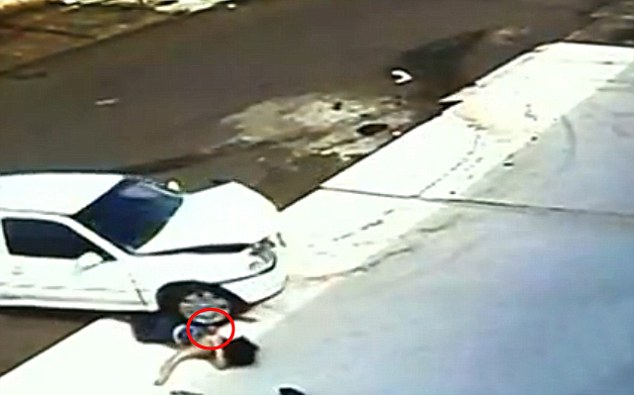 The car rolls right over the 5-year-old's head