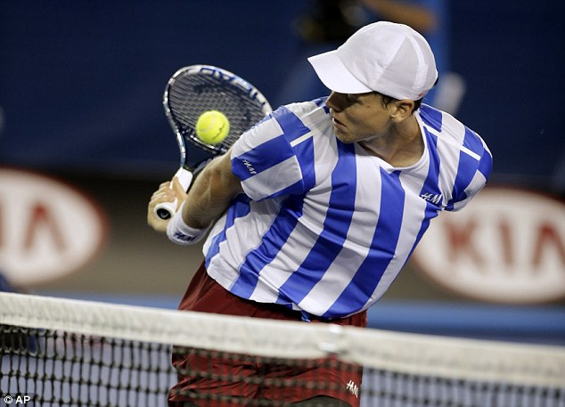 It's behind you: Berdych is forced to try and hit the ball unconventionally behind his back