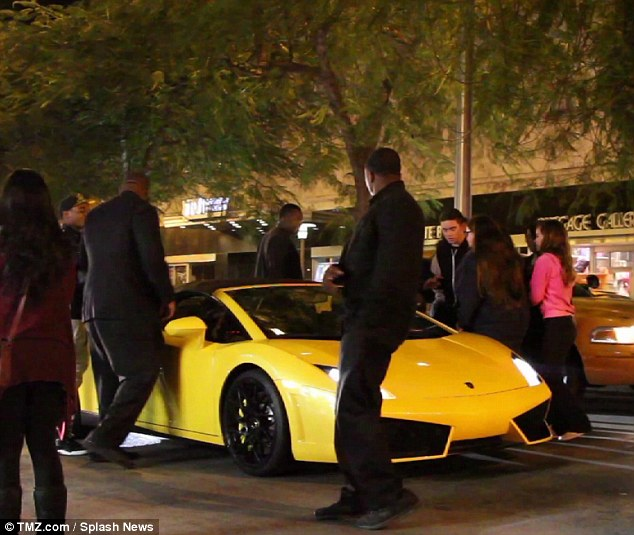 Stopped: The star in his yellow Lamborghini just before being pulled over after 4 am