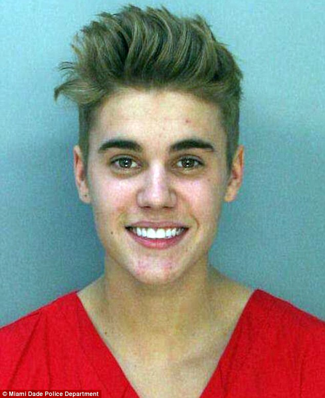 Booked: Justin Bieber was smiling for his mug shot after a Thursday morning arrest for a DUI and drag racing in Miami, Florida