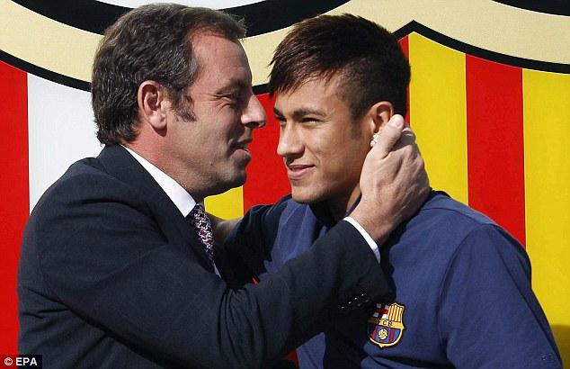 Under investigation: Sandro Rosell (left) unveiled Neymar (right) as Barcelona's new signing last summer
