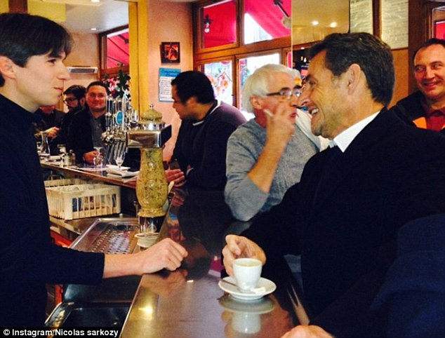 Creme of the crop? Nicolas Sarkozy recenlty posted a picture of himself on Instagram relaxing in a Paris cafe