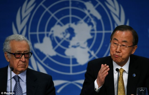 Mediating: U.N. Secretary-General Ban Ki-moon sits beside U.N.-Arab League envoy for Syria Lakhdar Brahimi as he addresses a news conference in Montreux on Wednesday