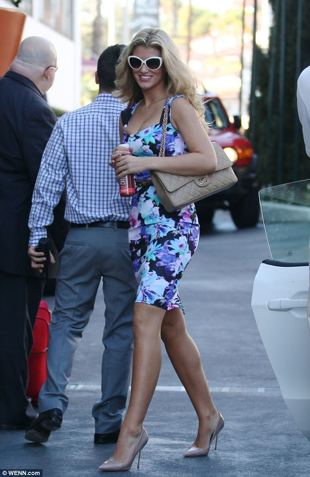 Living the dream: Amy wore a bright floral dress and white sunglasses as she attended meetings in LA