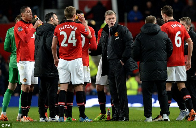 Tough tenure: Champions United, under new boss David Moyes (centre), should be performing far better