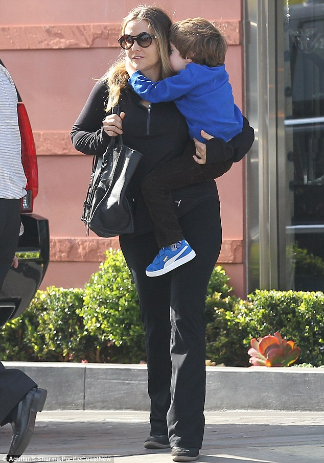 Change of heart: Brooke Mueller steps out with her son Bob as it is revealed that Charlie Sheen now supports her in their ongoing custody battle