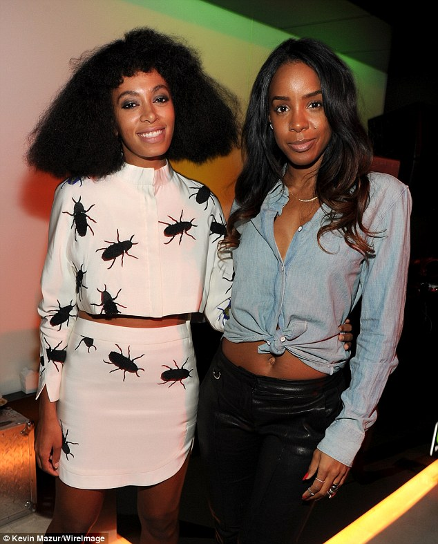 Gal pals: The 32-year-old singer - with Beyoncé's sister Solange - showcased her toned tummy in leather trousers and a cinched chambray top