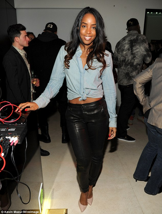 Fuss-free fiesta: Make-up free Kelly Rowland let her natural beauty shine through at the Spotify and Troy Carter pre-Grammy party in Culver City Thursday