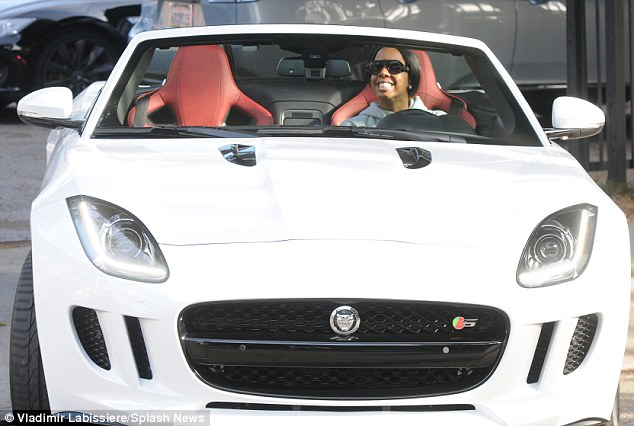 Vroom! The grinning X Factor judge then sped away in her white convertible sports car