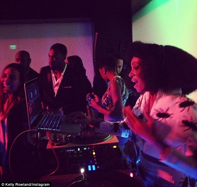 Eccentric: Rowland snapped this pic of Solange DJing the soiree in a whimsical wig and roach-patterned ensemble
