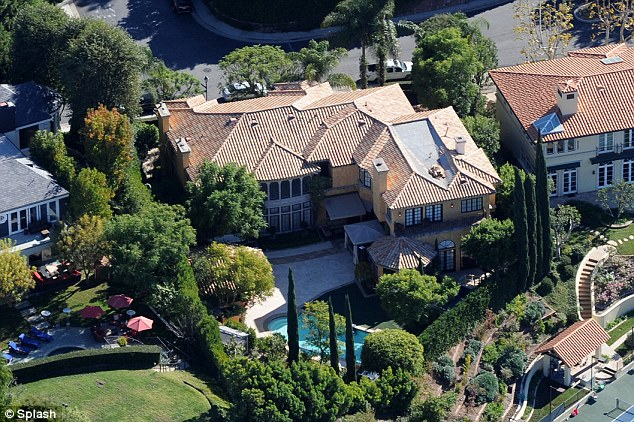 Not making any friends: The star's neighbours in the gated community of Mulholland Estates called the cops as the noise from the party grew to an unacceptable level