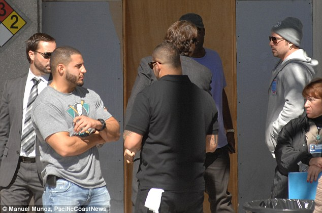Plan B? Jeremy Bieber (far right) meets with Justin's lawyers outside TGK prison on Thursday