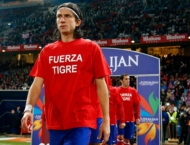 Tribute: Filipe Luis walks out with the rest of the team