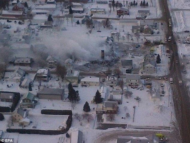 Blaze from the sky: An aerial handout photo shows the aftermath of the fire at the seniors home in L'Isle-Verte, Quebec