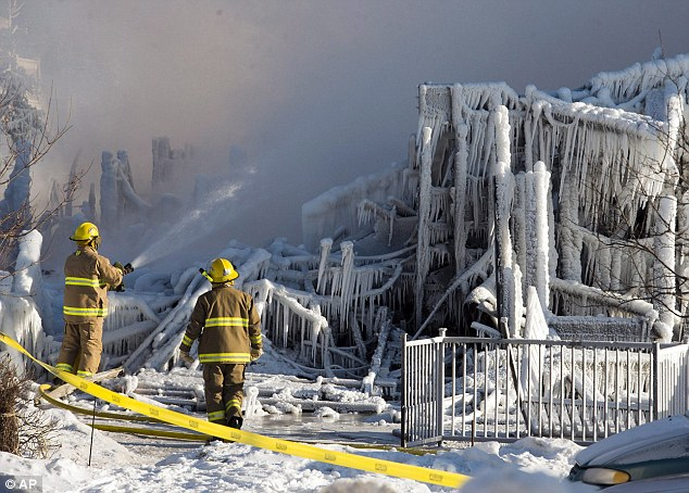 Frozen: Firefighters continued to douse the rubble where fire destroyed a a seniors residence leaving five people dead and 30 unaccounted for in L'Isle-Verte, Quebec, Thursday
