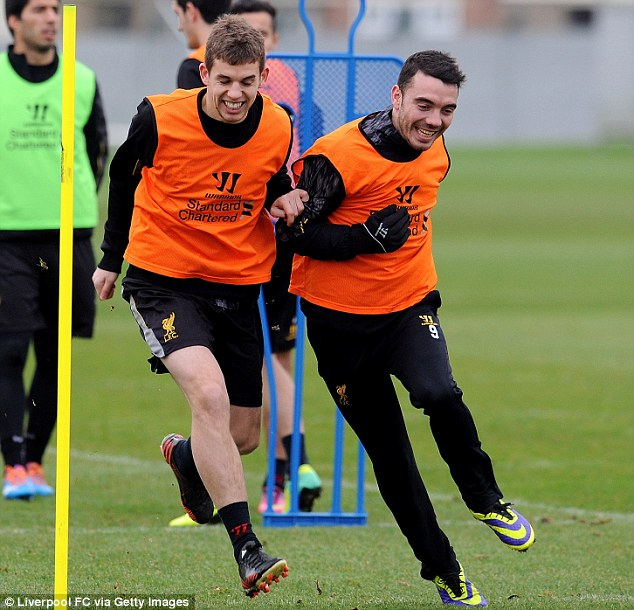Tussle: Jon Flanagan (left) battles with team-mate Iago Aspas in training but could feature for Liverpool in place of the injured Glen Johnson at right-back