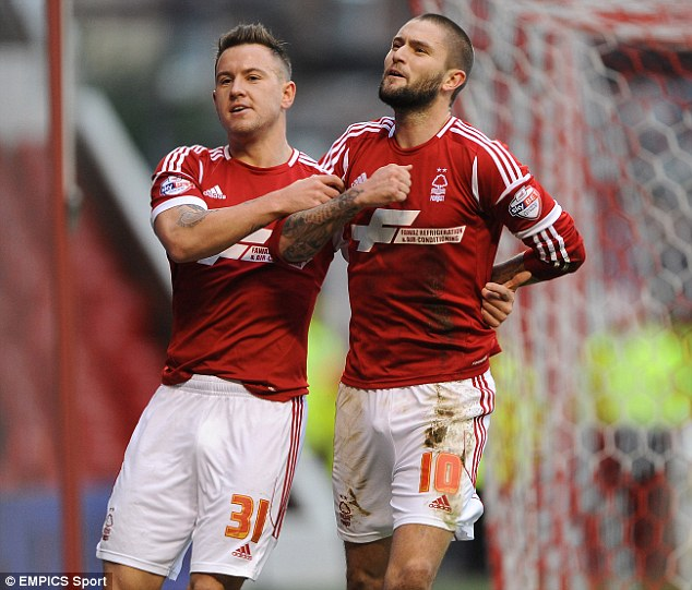 Spot on: Henri Lansbury (right) misses out having scored two penalty kicks for Nottingham Forest in their 4-1 win over Blackburn last Saturday. The midfielder celebrates the first here with team-mate Simon Cox.