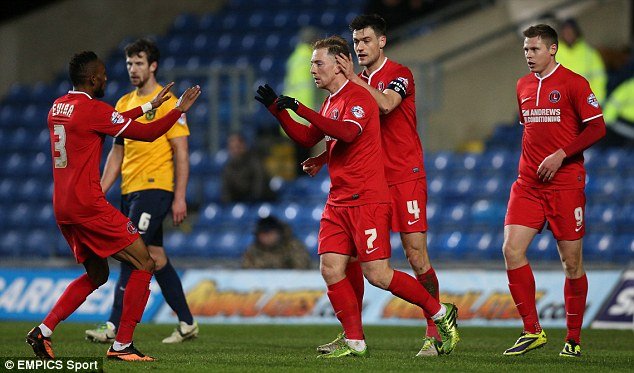 Easy path to round four: Danny Green celebrates scoring for Charlton in their third round victory over Oxford mid-week