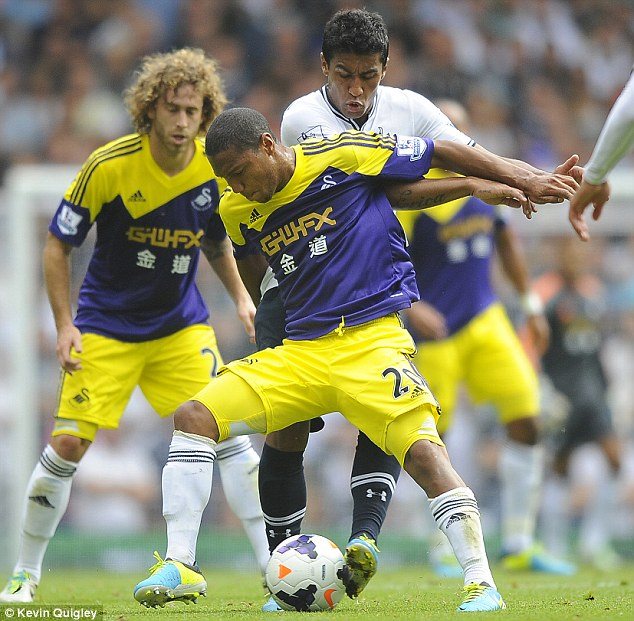 Back in contention: Jonathan de Guzman (front) is set to return from injury for Swansea