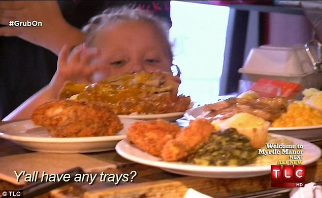 Getting their grub on: On their way home, the family stop in Savannah to enjoy a massive feast
