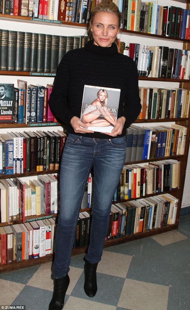 Best dressed in denim: Cameron Diaz looking smart in tightly fitted jeans and a black jumper at her book launch earlier this month